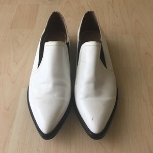 Sleek pointy toe white loafers